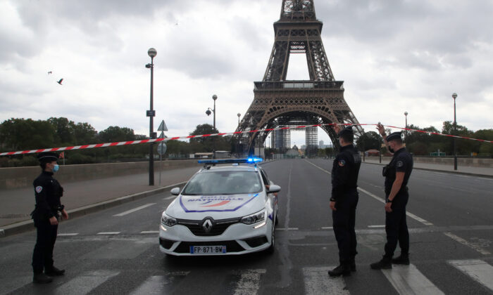 French police officers secure the bridge leading to the Eiffel Tower in Paris, on Sept. 23, 2020. (Michel Euler/AP Photo)