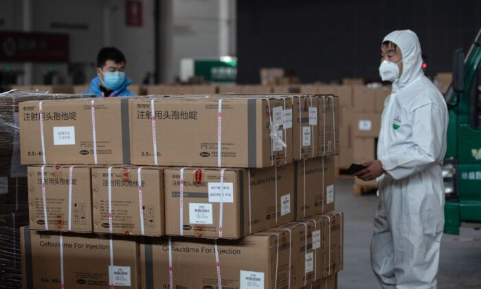 Staff members and volunteers transfer medical supplies at a warehouse in Wuhan on Feb. 4, 2020. (STR/AFP via Getty Images)