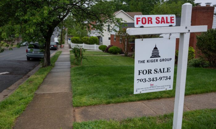 A for sale sign near houses in Arlington, Va., on May 6, 2020. (Andrew Caballero-Reynolds/AFP via Getty Images)