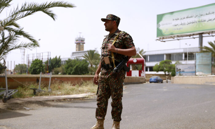 A guard stands outside Sana'a International Airport in Yemen on Sep. 23, 2020. (Mohammed Huwais/AFP via Getty Images)