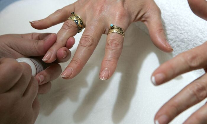 A file photo of a woman receiving a manicure at JT Nails in San Francisco, Calif. (Justin Sullivan/Getty Images)