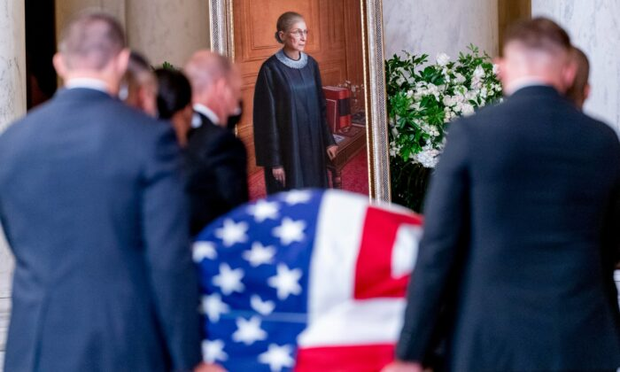 The flag-draped casket of Justice Ruth Bader Ginsburg, carried by Supreme Court police officers, arrives in the Great Hall at the Supreme Court in Washington, on Sept. 23, 2020. (Andrew Harnik, Pool/AP Photo)
