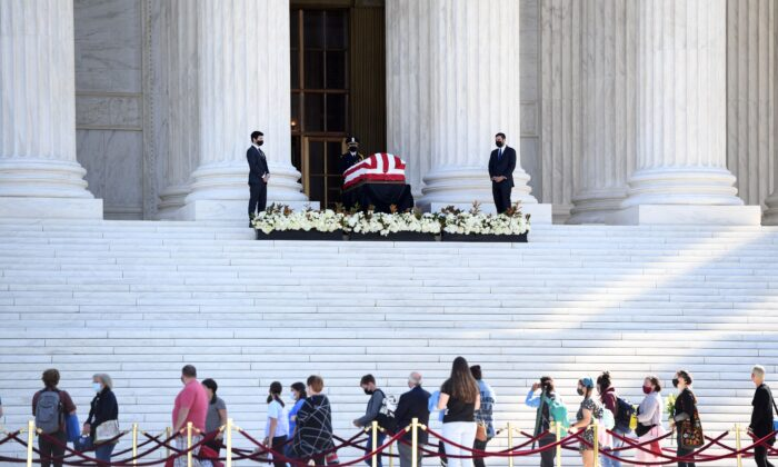 People pay respects as Justice Ruth Bader Ginsburg lies in repose in front of the Supreme Court in Washington on Sept. 23, 2020. (Saul Loeb/AFP via Getty Images)
