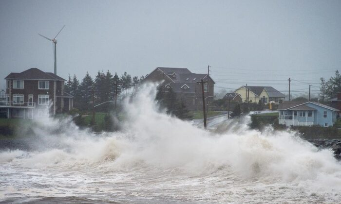 Waves batter the shore in Cow Bay, N.S., on Sept. 23, 2020. Hurricane Teddy has impacted the Atlantic region as a post-tropical storm, bringing rain, wind and high waves. (Andrew Vaughan/The Canadian Press)