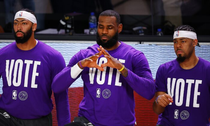 LeBron James (C) kneels with teammates during the national anthem before the Los Angeles Lakers-Denver Nuggets game in Lake Buena Vista, Fla., on Sept. 22, 2020. (Mike Ehrmann/Getty Images)