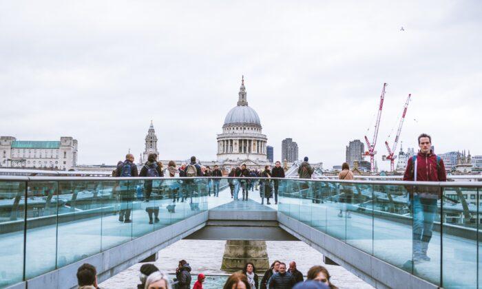 People are seen walking across Millennium Bridge in London in this file photo. (Luke Tanis/Unsplash.com)