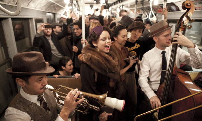 Passengers don period clothing on vintage subway cars in New York City on Dec. 8, 2013. (Samira Bouaou/Epoch Times)