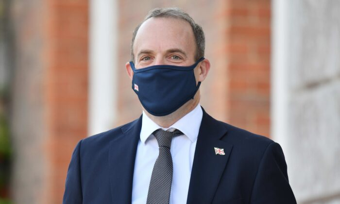 Britain's Foreign Secretary Dominic Raab wearing a protective mask waits to greet E3 foreign ministers at Chevening House in Sevenoaks, England, on Sept. 10, 2020. (Justin Tallis - WPA Pool/Getty Images)