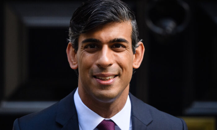 The Chancellor of the Exchequer, Rishi Sunak, who laid out further measures to aid the British economy and workforce as CCP virus cases continue to rise across the UK, poses for photographs outside 11 Downing Street in London on Sept. 24, 2020. (Leon Neal/Getty Images)