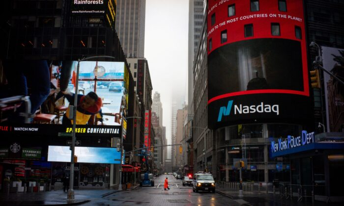 A man walks near Nasdaq MarketSite in an empty Times Square in New York City, on March 29, 2020. (Eduardo Munoz/Reuters)