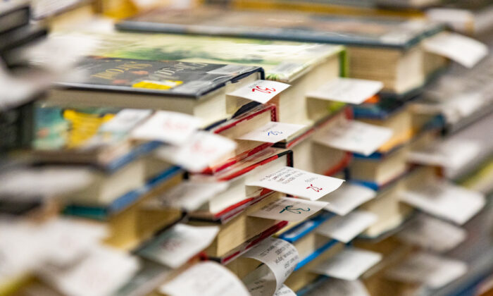 Library books that have been pre-ordered await pick-up at the Westminster Library in Westminster, Calif., on Sept. 22, 2020. (John Fredricks/The Epoch Times)