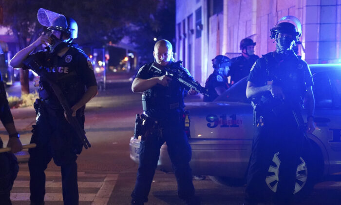 Police stand at an intersection after an officer was shot, in Louisville, Ky., on Sept. 23, 2020. (John Minchillo/AP Photo)