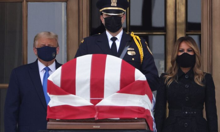 President Donald Trump and First Lady Melania Trump pay their respects to Associate Justice Ruth Bader Ginsburg's flag-draped casket on the Lincoln catafalque on the west front of the U.S. Supreme Court in Washington, on Sept. 24, 2020. (Alex Wong/Getty Images)