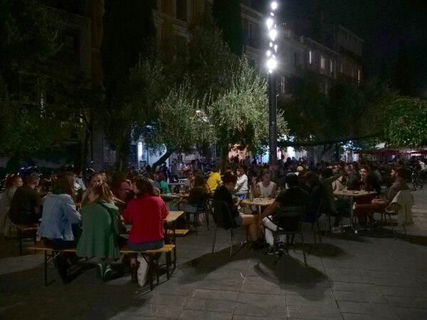 People on a terrace enjoy drinks after French authorities announced that they order cafes and restaurants to shut for two weeks to curb the spread of the coronavirus disease (COVID-19)