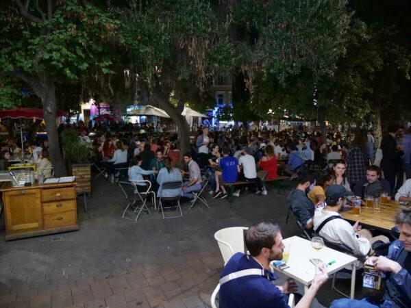 People on a terrace enjoy drinks