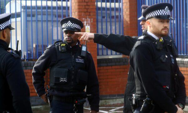 Policemen gather outside the custody centre
