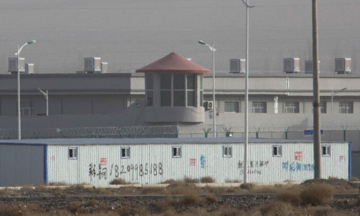 A guard tower and barbed wire fences are seen around a facility in the Kunshan Industrial Park in Artux in western China's Xinjiang region, on Dec. 3, 2018. (Ng Han Guan/AP Photo)