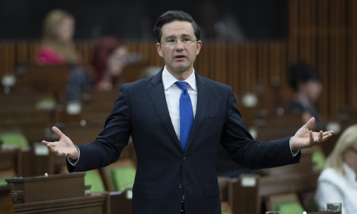 Conservative MP Pierre Poilievre rises in the House of Commons after the government delivered a fiscal snapshot in Ottawa on July 8, 2020. (Adrian Wyld/The Canadian Press)