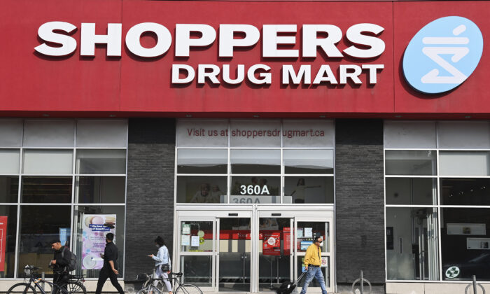 People leave a Shoppers Drug Mart where they are providing COVID-19 testing by appointment only during the COVID-19 pandemic in Toronto on September 25, 2020. (The Canadian Press/Nathan Denette)