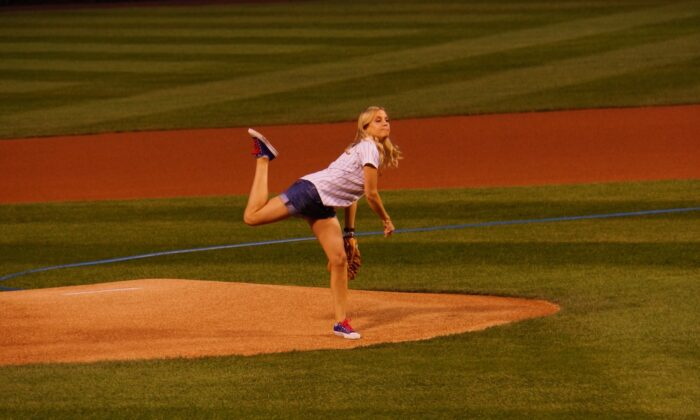 Katie Russell Newland throws the first pitch at Wrigley Field in Chicago. (Courtesy of Katie Russell Newland)