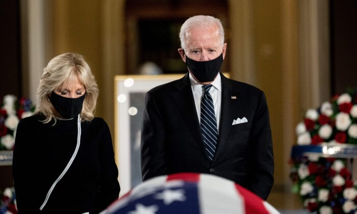 Democratic presidential nominee Joe Biden and his wife Jill Biden pay their respects to late Supreme Court Justice Ruth Bader Ginsburg at the U.S. Capitol, in Washington on Sept. 25, 2020. (Erin Schaff/Pool/AFP via Getty Images)