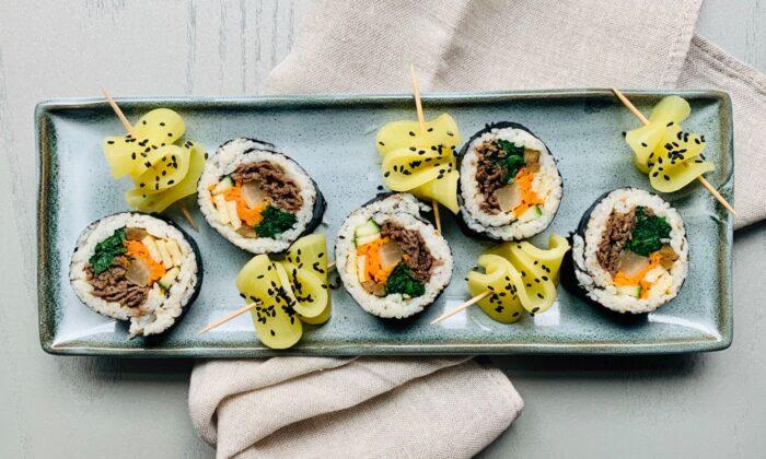Bulgogi kimbap, served with slices of danmuji, Korean yellow pickled daikon radish. (Judy Joo)