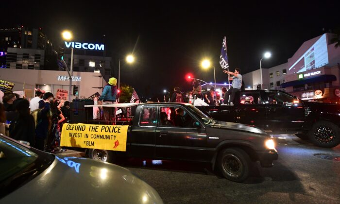Vehicules lead the demonstrators in Hollywood, Calif., on Sept. 24, 2020. (Frederic J. Brown/AFP via Getty Images)