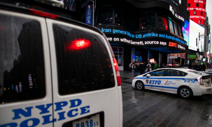 NYPD patrols stand guard at Times Square in New York City, N.Y., on Jan. 3, 2020. (Eduardo Munoz Alvarez/Getty Images)