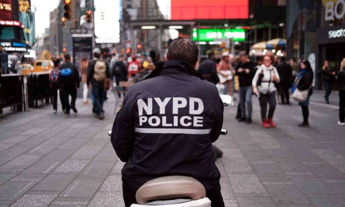 A police officer sits on a scooter in Times Square in New York City, on Nov. 5, 2019. (Spencer Platt/Getty Images)