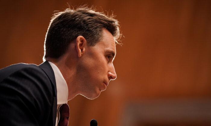 Sen. Josh Hawley (R-Mo.) listens during a hearing in Washington, Sept. 23, 2020. (Greg Nash/Pool/Getty Images)