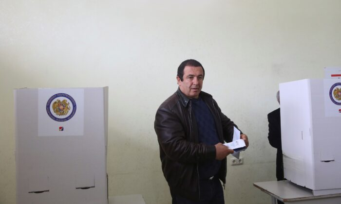 Businessman and opposition leader Gagik Tsarukyan votes during a parliamentary election at a poling station in Yerevan, Armenia, on Apr. 2, 2017. (Varo Rafayelyan/PAN Photo/Handout via Reuters)