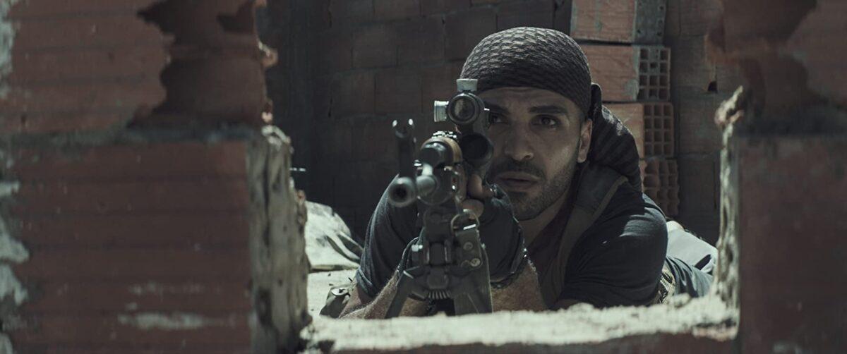 "Iraqi sniper on rooftop in ""American Sniper"""