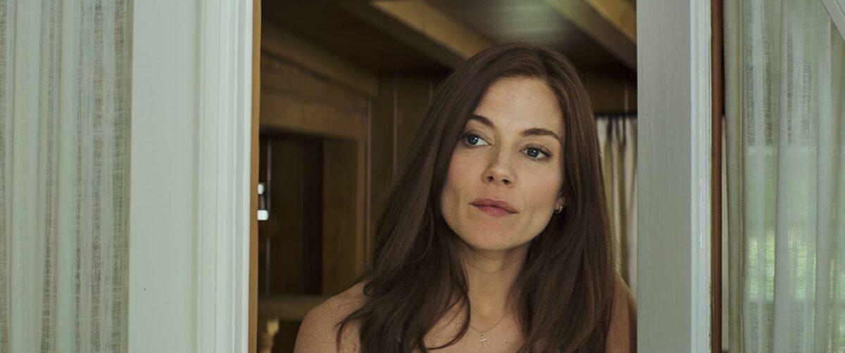 """brunette woman stands in doorway in """"American Sniper"""""""