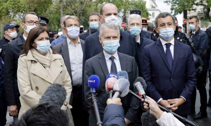 From the left, Paris mayor Anne Hidalgo, anti-terrorism state prosecutor Jean-Francois Ricard , and Interior Minister Gerald Darmanin answer reporters after a knife attack near the former offices of satirical newspaper Charlie Hebdo in Paris, on Sept. 25, 2020. (Lewis Joly/AP Photo)