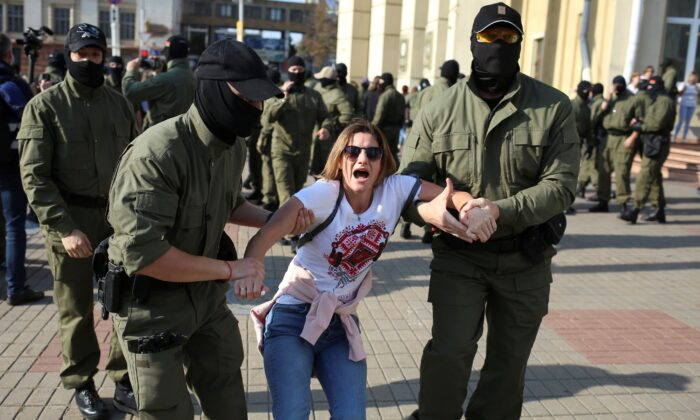 Belarusian law enforcement officers detain a woman during an opposition rally to reject the presidential election results and to protest against the inauguration of President Alexander Lukashenko in Minsk, on Sept. 26, 2020. (Tut.By via Reuters)