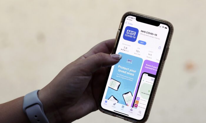 The coronavirus disease (COVID-19) contact tracing smartphone app of Britain's National Health Service (NHS) is displayed on an iPhone in this illustration photograph taken in Keele, Britain, on Sept. 24, 2020. (Carl Recine/Illustration/Reuters)