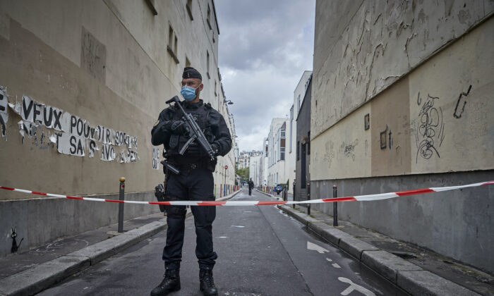 Armed police secure the area of around the former Charlie Hebdo headquarters, and scene of a previous terrorist attack in 2015, after two people were stabbed on Sept. 25, 2020 in Paris, France.  (Kiran Ridley/Getty Images)