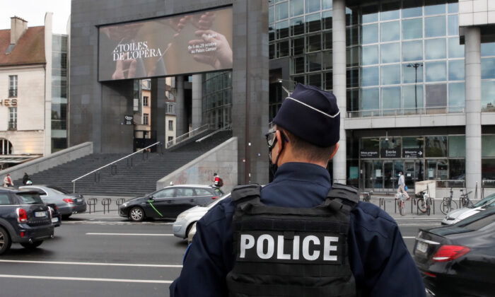A French policeman stands near the Opera Bastille where a suspect in a stabbing attack near the former offices of the magazine Charlie Hebdo has been arrested in Paris, France, on Sept. 25, 2020. (Gonzalo Fuentes/Reuters)