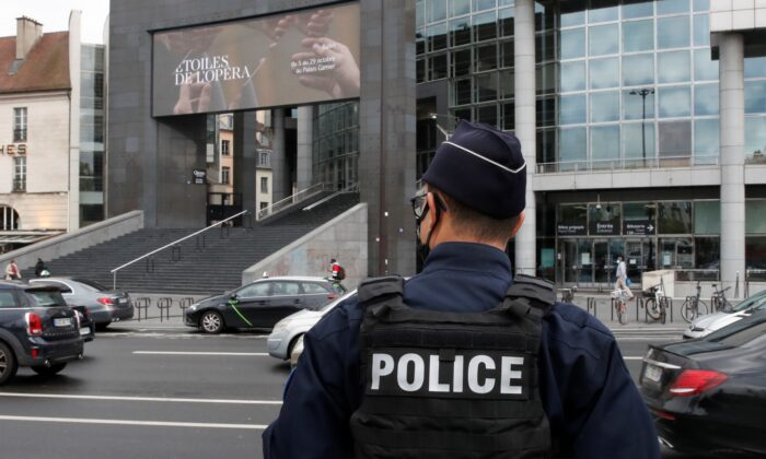 A French police stands near the Opera Bastille where a suspect in a stabbing attack near the former offices of the magazine Charlie Hebdo has been arrested in Paris, France Sept. 25, 2020. (Gonzalo Fuentes/Reuters)