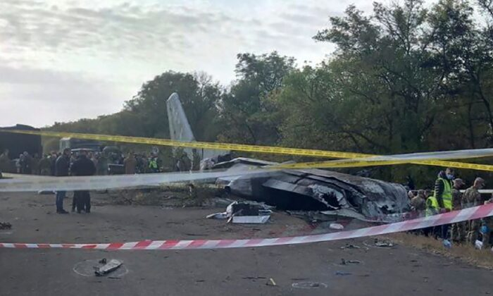 A view of the debris and remains of the An-26 military plane which crashed on Friday night in the town of Chuguyiv close to Kharkiv, Ukraine, on Sept. 26, 2020. (Emergency Situation Ministry via AP)