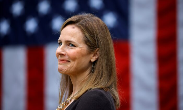 U.S. Court of Appeals for the 7th Circuit Judge Amy Coney Barrett reacts as President Donald Trump nominates her to the Supreme Court, in the Rose Garden at the White House in Washington on Sept. 26, 2020. (Carlos Barria/Reuters)