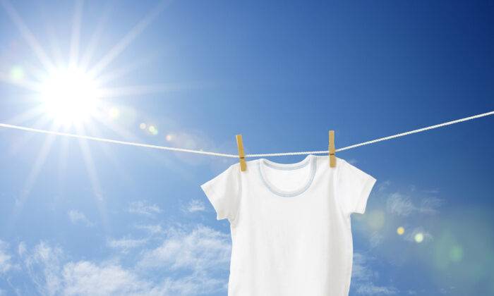 Rather than using bleach to remove perspiration stains from white T-shirts, you can try other options, such as white vinegar or hydrogen peroxide. (horiyan/Shutterstock)