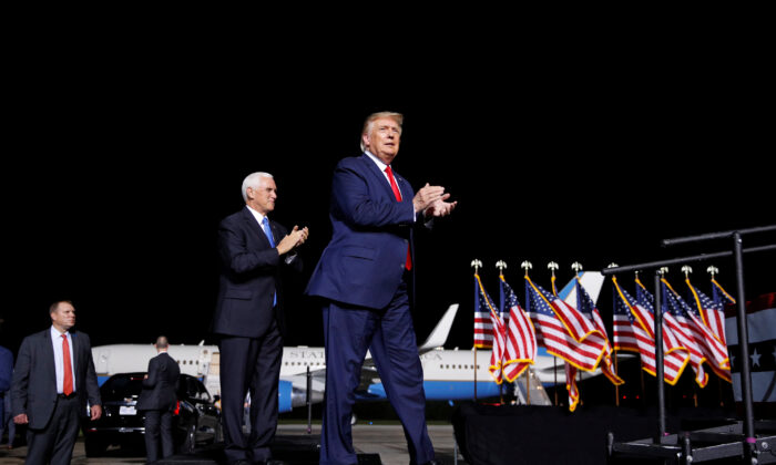 President Donald Trump accompanied by Vice President Mike Pence arrives at a campaign rally in Newport News, Va., Sept. 25, 2020. (Tom Brenner/Reuters)