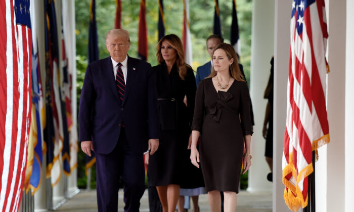 Seventh U.S. Circuit Court Judge Amy Coney Barrett's family and First Lady Melania Trump watch during Barrett's Supreme Court nomination ceremony, at the White House in Washington on Sept. 26, 2020. (Olivier Douliery/AFP via Getty Images)