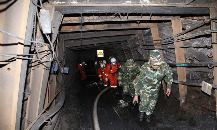 Rescuers race against time to pump water from a flooded coal mine where 22 miners were trapped underground on April 7, 2014 in Qujing, Yunnan Province of China. (Photo by Getty Images)