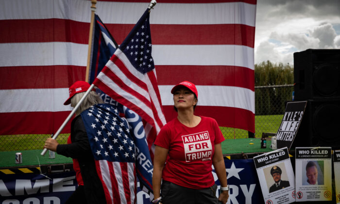 "An attendee wearing a ""Asians For Trump"" shirt stands as several hundred members of the Proud Boys and similar groups gathered for a rally at Delta Park in Portland, Ore., on Sept. 26, 2020. (Maranie R. Staab/AFP via Getty Images)"