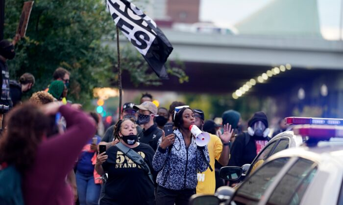 Black Lives Matter protesters march, in Louisville. Ky., on Sept. 25, 2020. (Darron Cummings/AP Photo)