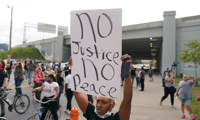 Victoria Gunther marches with Black Lives Matter protesters, in Louisville. Ky., on Sept. 25, 2020. (Darron Cummings/AP Photo)