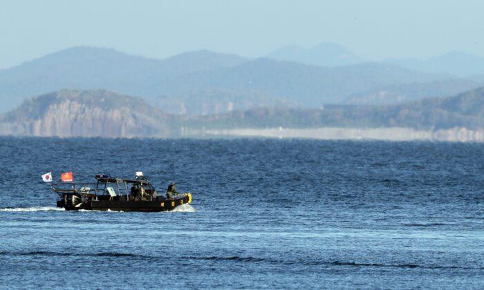 A South Korean marine boat patrols near Yeonpyeong island, South Korea, on Sept. 27, 2020. (Baek Seung-ryul/Yonhap via AP)