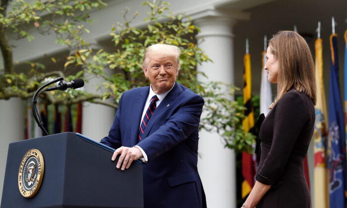 President Donald Trump, left, looks at Judge Amy Coney Barrett, during a ceremony announcing her nomination to the Supreme Court, in the Rose Garden of the White House in Washington, on Sept. 26, 2020. (Olivier Douliery/AFP via Getty Images)